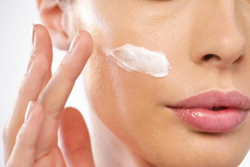 Lady applying skincare cream