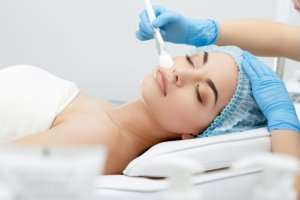 Lady having skin peel treatment