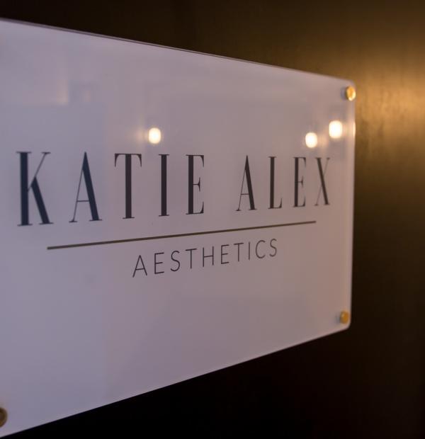 Katie Alex Aesthetics Logo on a door