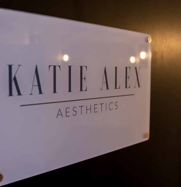 Katie Alex Aesthetics Logo on a door